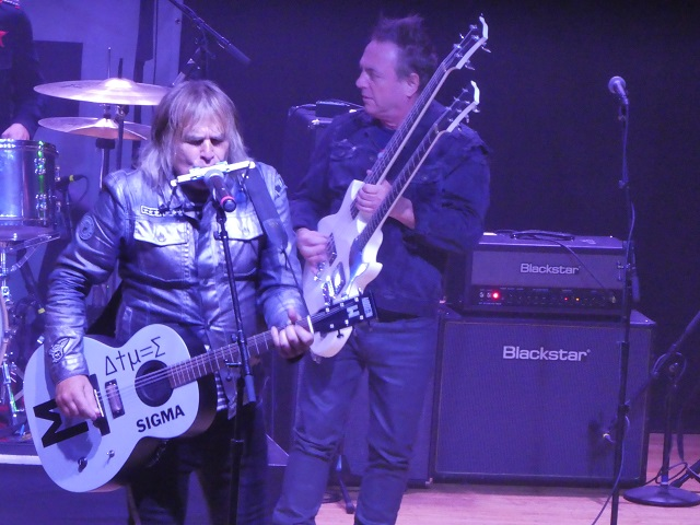 Mike Peters plays harmonica and guitar