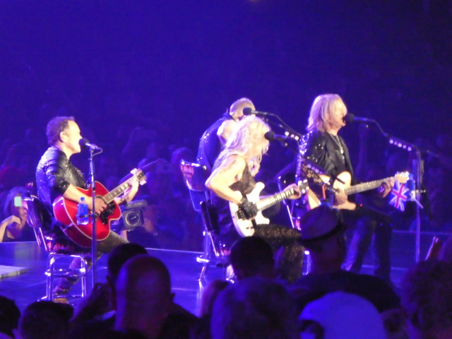 Heads in the way of Def Leppard stage