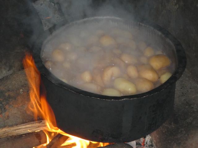 Boiling pot of potatoes in Rwanda
